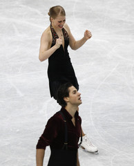 Canada's Weaver and Poje react after the ice dance free dance program at the ISU World Figure Skating Championships in Saitama