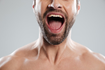Cropped image of excited mans half face with naked shoulders