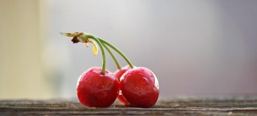Cherry macro on wooden table