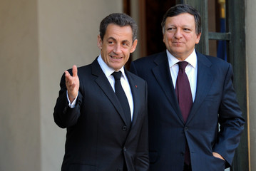 France's President Sarkozy accompanies European Commission President Barroso following a meetingat the Elysee Palace in Paris