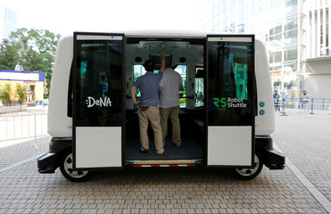 Japan's internet commerce and mobile games provider DeNA Co's 'Robot Shuttle', a driver-less, self driving bus, is seen during its demonstration in Tokyo