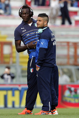 Italy's Balotelli and Insigne talk on the field before their international friendly match against Luxembourg at Renato Curi stadium in Perugia