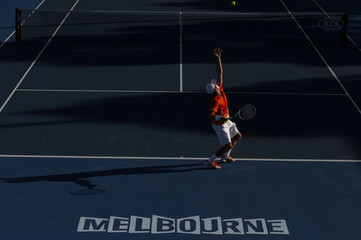 Mitchell of Australia serves to Isner of the U.S. during their men's singles match at the Australian Open tennis tournament in Melbourne
