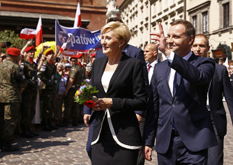 New Polish President Duda and his wife Kornhauser-Duda walk in the Old Town in Warsaw