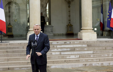 French Prime Minister Jean-Marc Ayrault leaves after reading a statement after the weekly cabinet meeting at the Elysee Palace in Paris