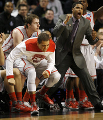 University of New Mexico's bench reacts during NCAA basketball game in Portland