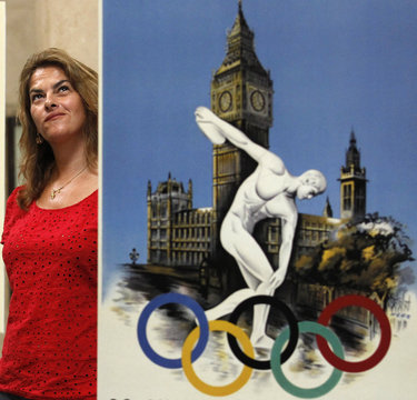 British artist Tracey Emin poses with a vintage Olympic poster at Tate Britain in London