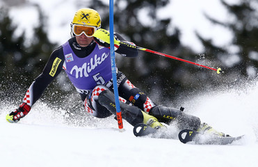 Kostelic of Croatia clears a gate during the first run of the men's World Cup slalom ski race in Wengen