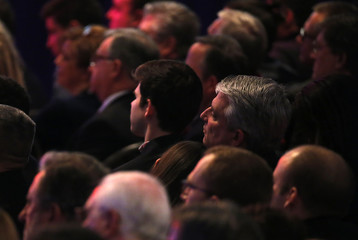 People in the audience listen to the Republican U.S. presidential candidates debate at the Republican U.S. presidential candidates debate sponsored by ABC News at Saint Anselm College in Manchester