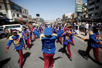 A military band takes part in a march during a ceremony marking Yemen's Reunification Day, in Sanaa