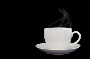 Black coffee in white cup on dark background