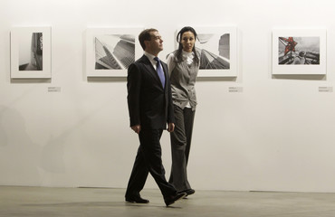"Russia's President Medvedev, accompanied by Trotsenko - chief of the project, visits the annual Russian photographic exhibition ""The best photos of Russia - 2009"" in Moscow"