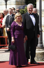 Bavarian Interior Minister Herrmann and his wife Gerswid arrive on the red carpet for the opening of the Bayreuth Wagner opera festival in Bayreuth