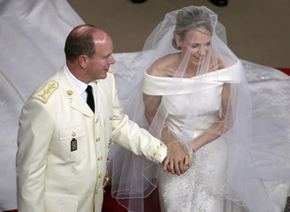 Monaco's Prince Albert II and Princess Charlene exchange rings during their religious wedding ceremony at the Palace in Monaco