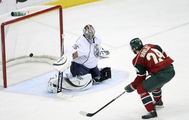 Minnesota Wild right wing Havlat scores against Oilers goaltender Khabibulin during NHL game in St Paul