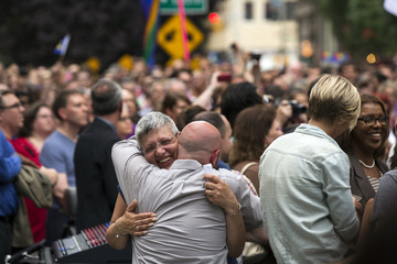 Marriage equality activist Cathy Marino embraces fellow activist Ron Zacchi in New York