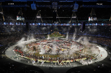 Athletes of participating countries stand in the middle of the Olympic Stadium during the athletes parade at the opening ceremony of the London 2012 Olympic Games