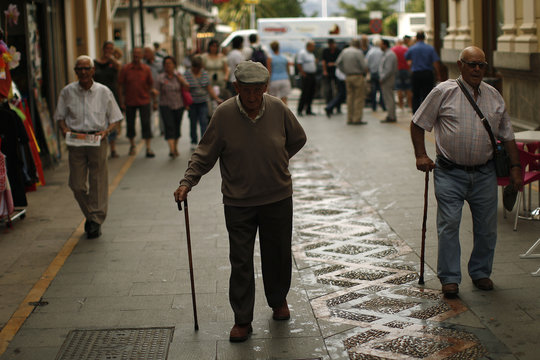 Pensioners walk along La Bola street during the International Day of Older Persons in downtown Ronda