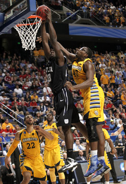Butler University's Marshall fights to get his shot off under pressure from Marquette University's Otule during their third round NCAA basketball game in Lexington