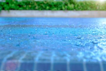 Heavy rain in the blue swimming pool