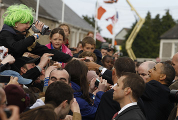 U.S. President Barack Obama shakes hands with a crowd of local residents in his ancestral home in Moneygall