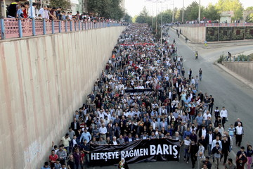 People march in Diyarbakir, Turkey, to protest the double suicide bombing in Ankara that killed up to 128 people