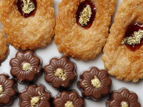 Biscuits and chocolates are decorated with gold leaf flakes from Erich Dungl's gold leaf workshop in Schwechat