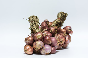 Group of red onion on white background,selective focus.