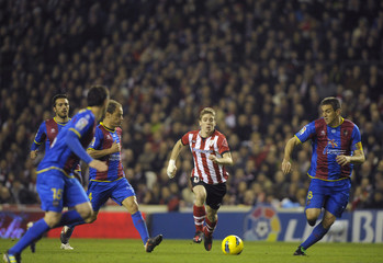 Athletic Bilbao's Muniain is pursued by Levante players during their Spanish first division soccer match in Bilbao