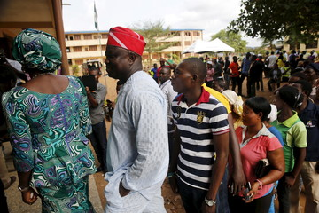 Governorship candidate of APC, Akinwunmi Ambode stands in a line for accreditation at the beginning of governorship election in Epe