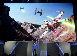 """Sigurlina Ingvarsdottir, senior producer at EA Digital Illusions Creative Entertainment, introduces the new video game """"Star Wars Battlefront"""" during Electronic Arts media briefing before the opening day of the E3 in Los Angeles"""