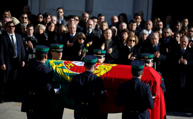 The coffin of former President and Prime Minister of Portugal Mario Soares is carried by army personnel, in Lisbon
