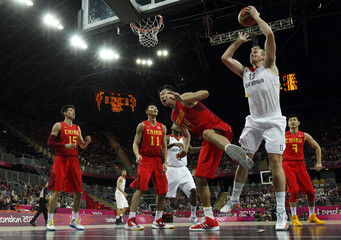 Great Britain's Clark grabs the rebound from China's Wang during their men's preliminary round Group B basketball match at the Basketball Arena during the London 2012 Olympic Games