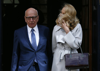 Media mogul Rupert Murdoch and Jerry Hall pose for a photograph in London
