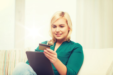 happy woman with tablet pc and credit card