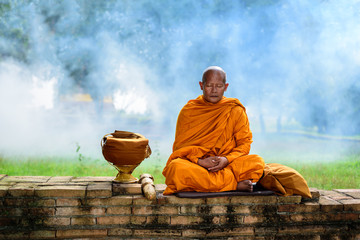 Asian monk sitting for vipassana