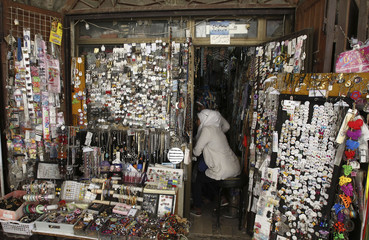Syrian women shop inside a jewellery store in old Damascus