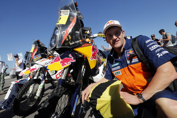 Spain's rider Marc Coma on KTM motorcycle arrives for technical verification ahead of the Dakar Rally 2014 in Rosario