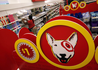 Employee at the new CityTarget store checks the stock on the shelves during preparations for its opening in downtown Chicago