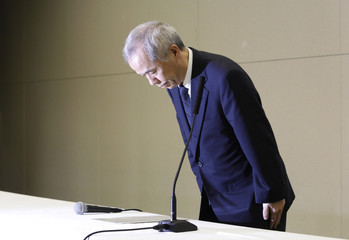 Tokyo Electric Power Co incoming President Naomi Hirose bows at the start of a news conference in Tokyo