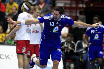 France's Karabatic celebrates after scoring against Denmark during their Men's Handball World Championship final match in Malmo