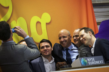 Thomas Hartwig, Riccardo Zacconi, Stephane Kurgan and Sebastian Knutsson pose for a photo before ringing the opening bell during the IPO of Mobile game maker King Digital Entertainment Plc on the floor of the New York Stock Exchange