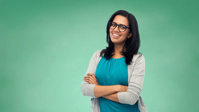 happy smiling young indian woman in glasses