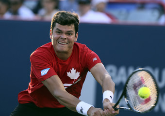 Raonic of Canada hits a return to France's Chardy at the Rogers Cup tennis tournament in Montreal