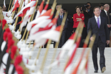Brazil's President Rousseff watches as Britain's PM Cameron leaves after a meeting at the Planalto Palace in Brasilia