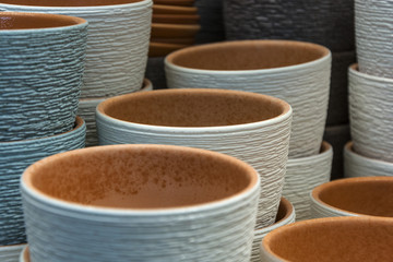On a shelf of clay pots for flowers