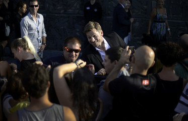 Fans take pictures with Danish actor Nikolas Coster-Waldau following a photocall at the San Sebastian Film Festival