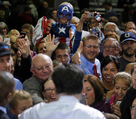 A boy wearing a Captain America costume is seen among audience members as they are greeted by U.S. Republican presidential nominee Romney at a campaign rally in Celina