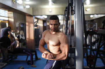 An Iraqi Shi'ite bodybuilder poses for a picture at a fitness centre in Sadr City in Baghdad