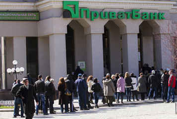 People line up outside a bank in the Crimean city of Simferopol